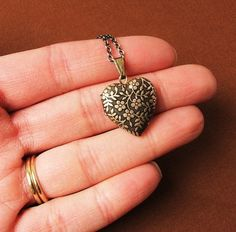 Note- this is the tiny, mini version of my popular Forget Me Not heart locket. I thought it best to not add any dangles or any other distraction that would take away from its simple and ultra feminine design. Its so precious, itll make you swoon!  By popular demand, Im now offering fabulous lockets that are empty inside for you to mount and insert your own pictures! Youve asked for it...youve got it!  This is the perfect locket to feature your own pictures, artwork, a special memento or a…