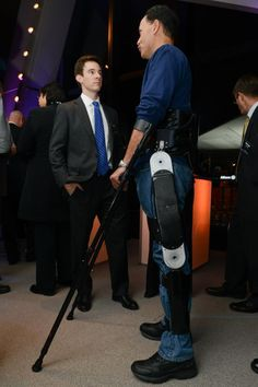 Dr. Ryan Farris with Michael Gore who is wearing the Indego exoskeleton - images by Popular Mechanics