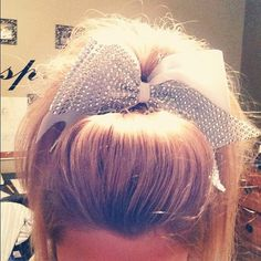 Teased hair & rhinestone bow <3 I might be a retired cheerleader but I still WANT THIS!