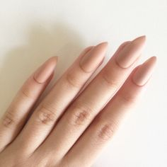Matte nude stiletto nails, hand painted acrylic nails, fake nails,... (£10) ❤ liked on Polyvore featuring beauty products, nail care and nail treatments