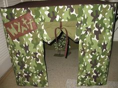 Sew Much Ado: Card Table Playhouse Tutorialette.  Would not do camo, but good tips here for a card table house.