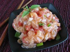 """SALMON CEVICHE - I ordered """"lomi lomi salmon"""" off a menu at a small mom and pop neighborhood restaurant. What a surprise I had when the dish was made with fresh salmon and not the traditional salted salmon we are all so accustomed to here.  The combination of flavors in this SALMON CEVICHE recipe marry well with the fresh salmon. Feel free to serve immediately or allow to marinate.   Get this recipe by clicking on the link below: http://ow.ly/DtCO301poaL"""