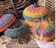 """Free pattern notion boxes. Cute 3"""" containers with Lily Sugar & Cream. Description says knitted but it is crochet."""