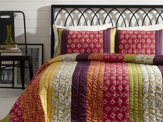 New for 2015 the Emma Set - This Bella Taylor Home set comes with a quilt and 2 shams. The Emma collection is a strip quilt of bright and fun pops of dark purple, bright pinks and accents of yellow and green. The back of the quilt is a solid green. King $159.95, Queen $139.95, Twin 119.95