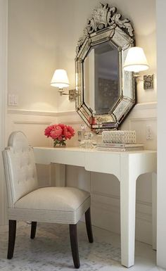 A place to powder one's nose? The sconces, ornate mirror, and white faux alligator table are just the right mix of traditional and modern.