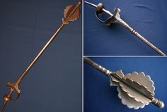 Indian (mughal) steel mace, eight knife edged flanges below a rounded finial, cylindrical haft with a Khanda sword type basket hilt. Length 39.75 inches.