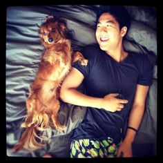 """guysanddogs: """"For some reason, he likes to sleep like this."""" - Ryan Higa on his dog Marley"""