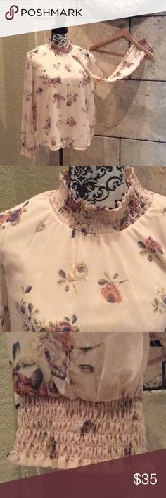 Beautiful long sleeve top Beautiful long floral top with long sleeve. New with tags. Please let me know if you need more pictures please ask. No refund or exchanges. All sales are final. Tops