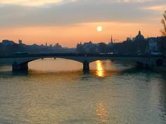 Luminous sunrise over the Cité and the right bank. From the Pont Royal, Paris.