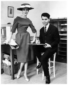Young Karl Lagerfeld ( now designing for the House of Chanel) with a model at the House of Jean Patou, 1959. Note the off shoulder designed sleeving..pleated(puffed) waistline & slightly flared, midi skirting....