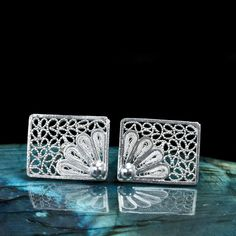 SILVER FILIGREE STUD EARRINGS FLOWERS AND LACE Handmade silver filigree earrings for pierced ears. These stud earrings include a variety of unique patterns created through winding, twisting and bending silver threads. They are made of starling silver filigree 9.50.