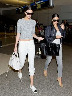 Kendall Jenner's white sneakers with metallic toes are beyond amazing and pair perfectly with her white scrunched pants. // #Style