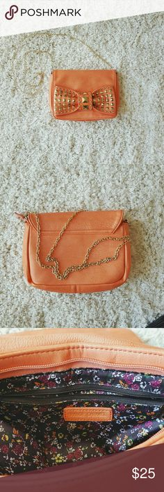 Coral Leather Bag With Gold Stud Detail Leather coral color, over-the-shoulder purse with gold chain strap 10.5 inches wide, 8 inches tall Small zipper pocket inside Zips to close and has magnetic snap Minor wear includes small scratches on studs, small pen mark on inside of flap, and wearing of leather on side of top flap and bottom right Orange Caramel Bags