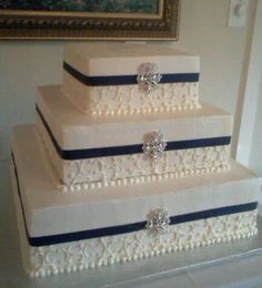Square Brooch Wedding Cake with navy ribbon and elegant piping by Cake Hag