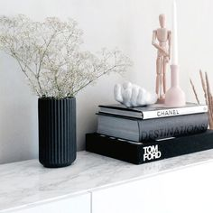 Coffee Table Stacks Bonus points for keeping 'em all neutral. Tom Ford and Chanel? Obviously. #refinery29 http://www.refinery29.com/fashion-home-decor-items#slide-8