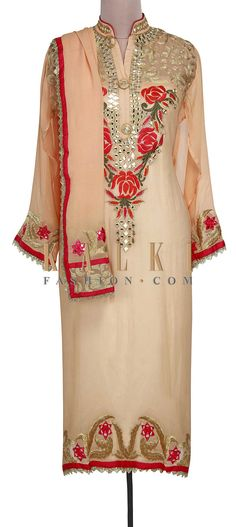 Buy Online from the link below. We ship worldwide (Free Shipping over US$100). Product SKU - 301005. Product Link - http://www.kalkifashion.com/beige-semi-stitched-suit-featuring-in-mirror-and-resham-embroidery-only-on-kalki.html