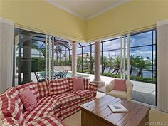 Country chic - yellow family room with red and white checked sofa - Naples, Florida - The Moorings