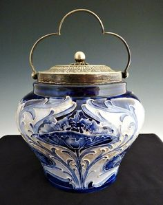 William Moorcroft Florian Ware biscuit jar with poppy design and silver mounts ~James MacIntyre pottery