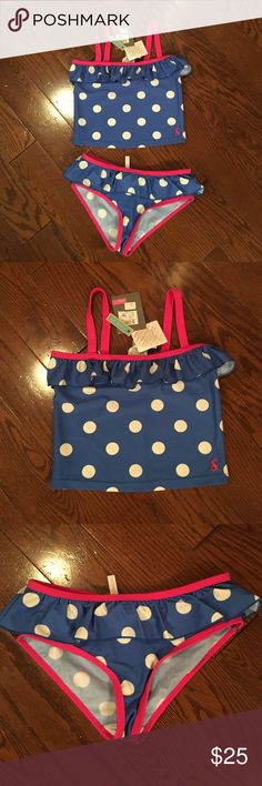 Joules two piece swimsuit NWT. Girls 7-8 Blue with white polka dots and pink trim. Ruffle on top of bottom and top. So cute. Girls 7-8 Joules Swim Bikinis