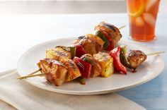 Make these better-for-you Sweet BBQ Chicken Kabobs at your next barbecue. These Sweet BBQ Chicken Kabobs have an island vibe thanks to the OJ & pineapple. Grilled Chicken Kabobs, Chicken Kabob Recipes, Grilling Recipes, Grilled Calamari, Grilled Halloumi, Chicken Skewers, Barbecued Chicken, Grilling Ideas, Marinated Chicken