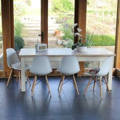 Painted Classic Table With Eames Style Chairs