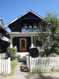 Hillhurst-226 11A St NW Calgary. Love the Yellow door and upper balcony. Nothing like a white picket fence!