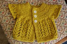 This is knit, but the idea, I think, would translate well to crochet. I like the simple yoke and lacy sleeves and body. Pattern is Baby Sweater on Two Needles (February) by Elizabeth Zimmermann.