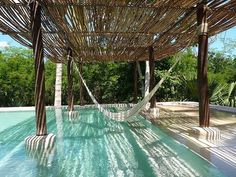 Hammock in the pool. And I love the way they created partial shade over the pool… Hammock in the pool. And I love the way they created partial shade over the pool. Outdoor Spaces, Outdoor Living, Outdoor Decor, Backyard Hammock, Hammocks, Hammock Ideas, Backyard Pools, Pool Decks, Pool Landscaping