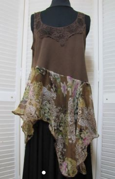 Top cut at bottom on an angle, sew on sheer camisole to make asymmetrical tunic.