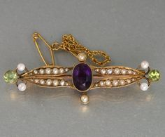 EDWARDIAN 15CT GOLD SUFFRAGETTE BROOCH WITH AMETHYST, PERIDOT PEARLS c 1900's click picture to enlarge click picture to enlarge click picture to enlarge click picture to enlarge click picture to enlarge click picture to enlarge.