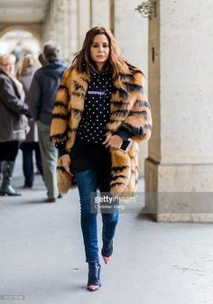Christine Centenera is wearing a fur coat outside Dior during the Paris Fashion Week Womenswear Fall/Winter 2016/2017 on March 4, 2016 in Paris, France.