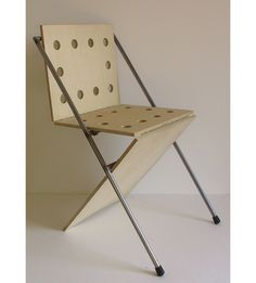 """CHAIR """"sitting bull"""" is a collapsible chair, completely demountable in its main elements. It is composed by three hinged birchen panels and by a tubular metallic structure."""