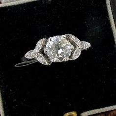 Generally prefer Edwardian/Art Deco to Victorian but this is really lovely and a very Edwardian style. Really like rings with leaf shaped sides/shoulders. And it's my exact ring size (5.5) and in London! Only reservation is that it might stick up a bit much but hard to tell. 0.77ct Old Mine Cut Diamond Solitarie Ring in Platinum - Farringdons Jewellery Hatton Garden London £2750