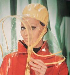 Sophia Loren ready for a downpour, 1960s.