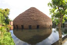 Vietnamese designers Vo Trong Nghia combined natural materials like bamboo with contemporary design practices to create the wNw Bar in Thu Dau Mot Town, Binh Duong, Vietnam.    Besides being culturally relevant, the bamboo structure also employs environmental functions, by drawing cool air from the surrounding water up through a hole in the roof of the structure.