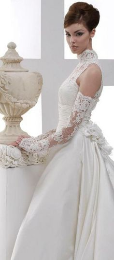 Love this beautiful lace gown. Not sure who designed it though.