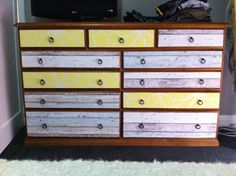 Wallpapered chest of drawers. Bring life back into boring ones!