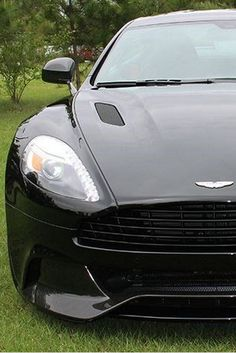 This elegant Aston Martin Vanquish has some serious power! Click on the image to discover more. #coolwhip #spon
