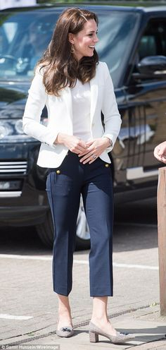 Kate showed off a chic new look in tailored trousers... Catherine's nautical looking outfit -- white top and jacket, navy cropped trousers with gold button detail, flat shoes with tassels. June 16 2017