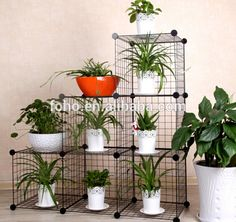 modular wire cube shelves | vertical garden | DIY | only thing is, the plastic connectors for these shelves are always extremely shitty and I wouldn't trust them to hold up anything, mush less heavy plants. But, they can be repurposed — connected some other way, used to top off a DIY copper pipe shelf, make a DIY plant stand, used as a wall trellis, etc.