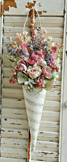 Country Flowers in a sheet music wall pocket.