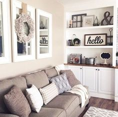 Living room decorating ideas - LOVE these neutral colors and farmhouse style! living room decor / farmhouse industrial / how to style a bookshelf / living room home decor inspiration / cozy living room