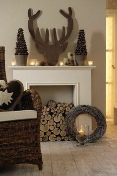 fausse cheminee avec tete de cerf et bois