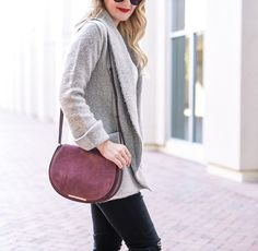 Visions of Vogue carrying the Cuyana Saddle Bag in Oxblood Suede and Leather.