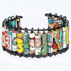 Thinking paper beads on safety pins in order to make a similar bracelet should be fun!
