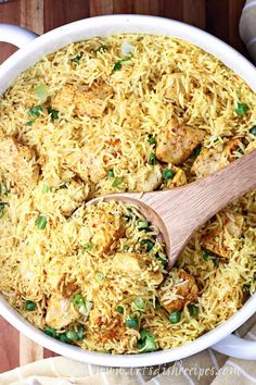One Pot Yellow Chicken and Rice Recipe -- The whole family will love this simple but delicious chicken and rice casserole that bakes up in a 9x13 pan for easy clean-up. Sure to become a go-to recipe for busy week nights.