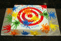 Greyson's Paintball Cake - This cake was for a 12 year olds birhtday party.  the cake is white with butter  cream frosting.  The paint balls are gumballs.  The boys all had to have a gumball on their piece of cake so it was cut funny to accomidate.  What a hit for 12 year olds.