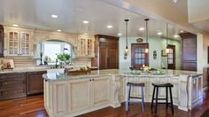 Beautiful large Tuscany style kitchen remodel with 19 linear feet of working countertop space on the island alone.     The wall that separated the living room from the kitchen has been removed, creating a useful and enjoyable great room.