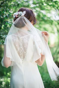 Such a romantic flair about this draping veil, which fastens with two small…