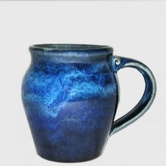 """Handmade in the USA 14 oz Round Pottery Coffee Mug - Midnight Blue - Approximately 4.25"""" tall x 3"""" wide at mouth. Holds 14 ounces. Please note - due to their handmade nature each piece will vary slightly in glaze and dimension."""